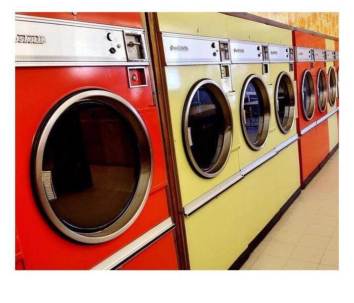 Commercial Red and Yellow Dryers Lined Up In A Row.