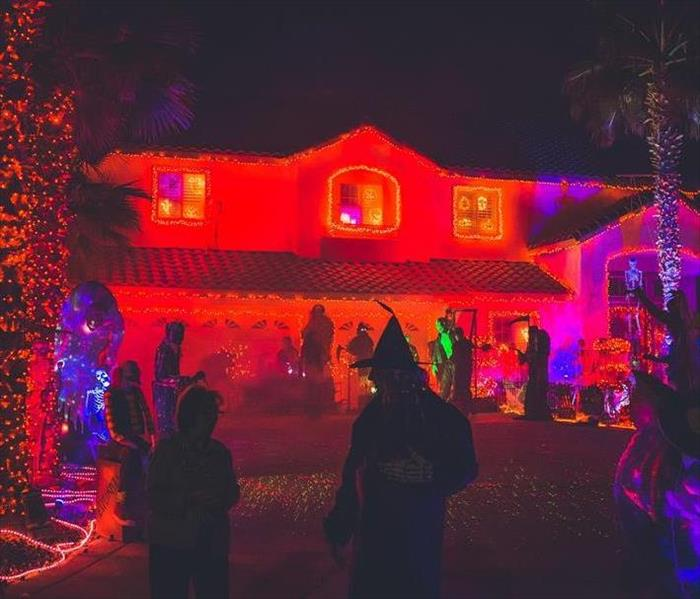 Trick or Treating In Front of a House