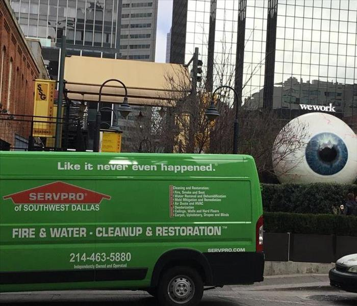 green SERVPRO van outside commercial building